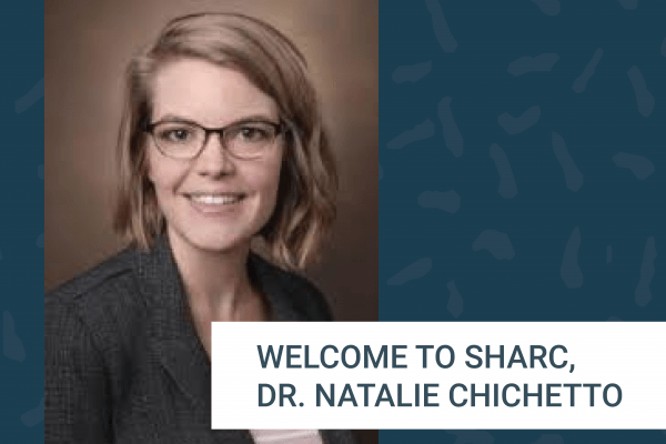 Teal background with Dr. Chichetto's photo with a welcome to SHARC message