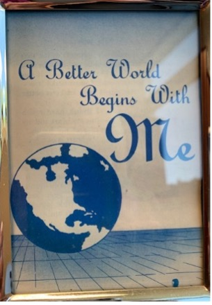 """Image with a globe and the quote """"a better world begins with me"""""""